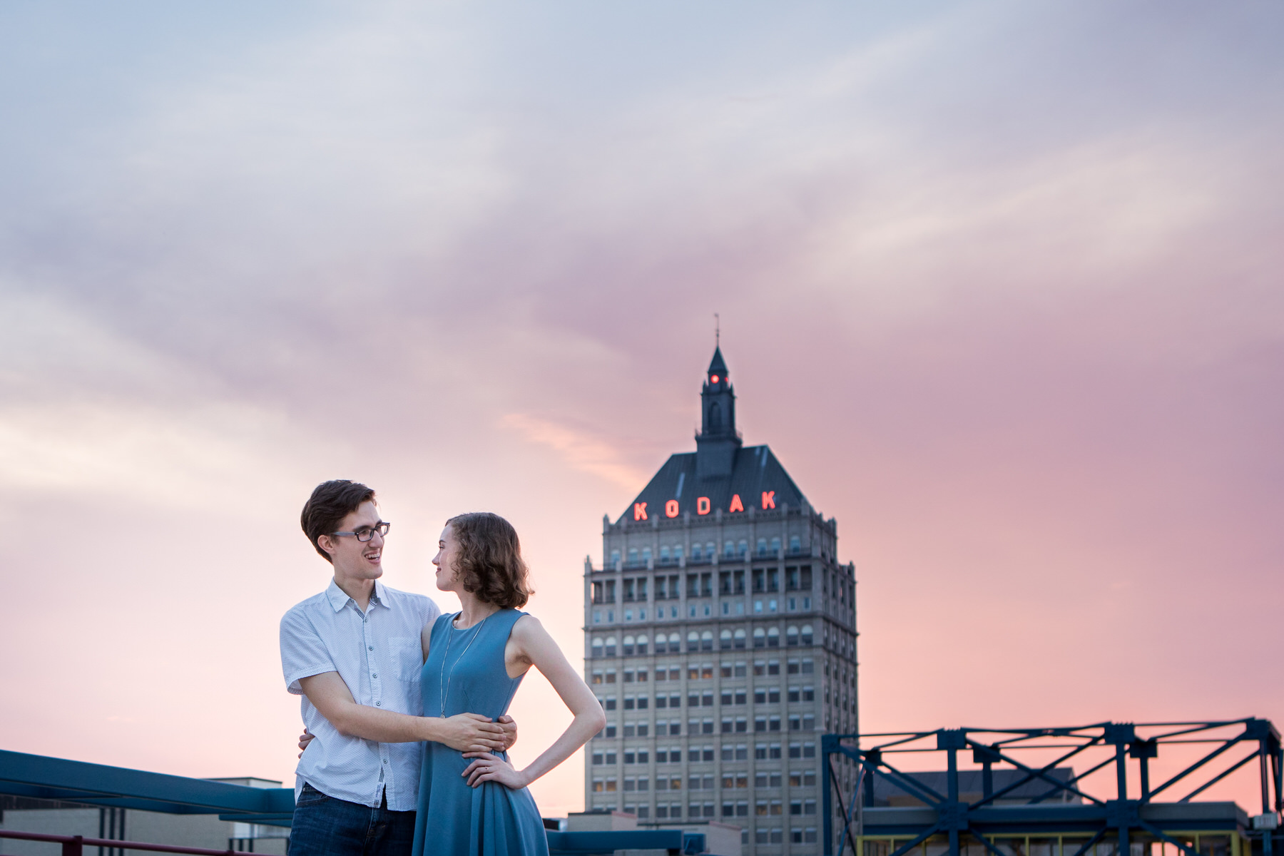 Couple at Sunset with Kodak Building