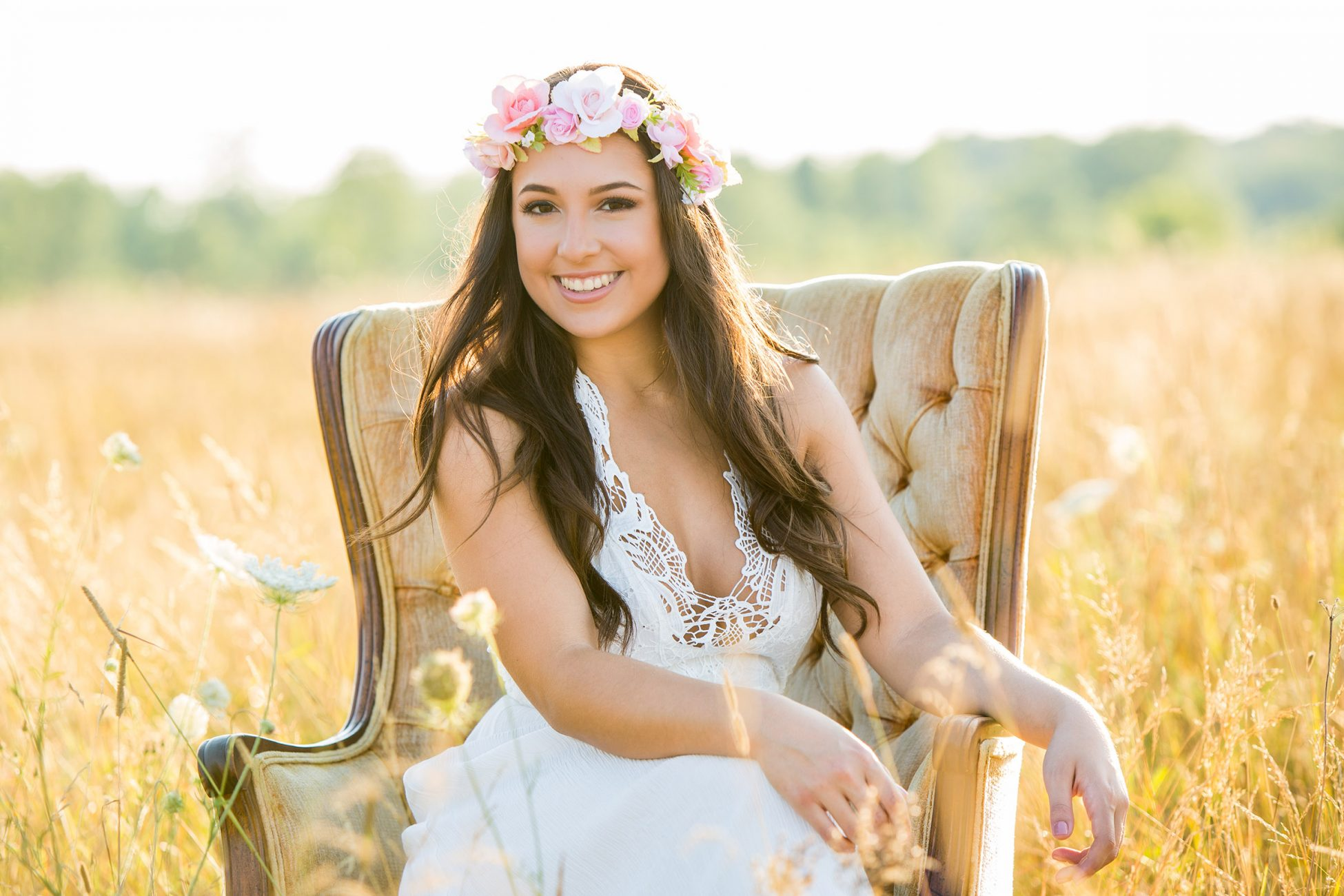 Boho Senior Girl with flower crown in a field